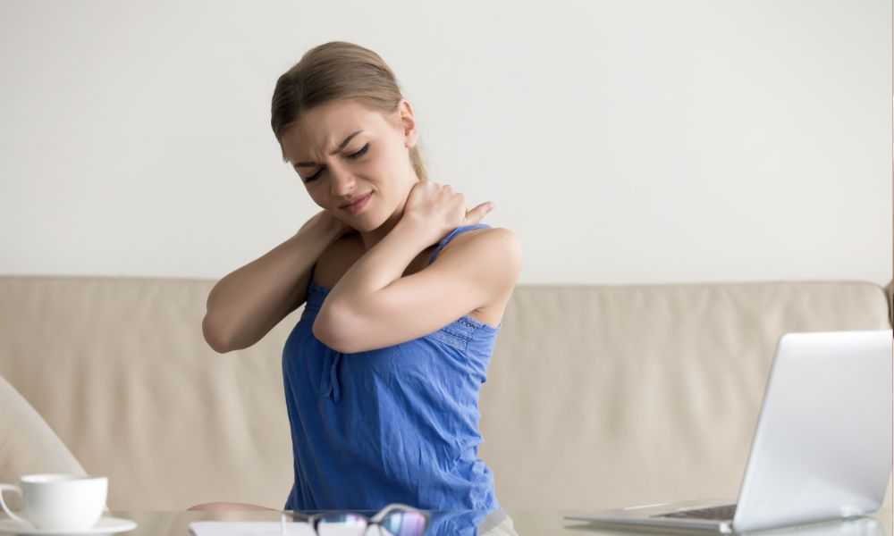 Woman feeling neck pain