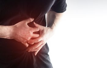 a person suffering from severe abdominal pain